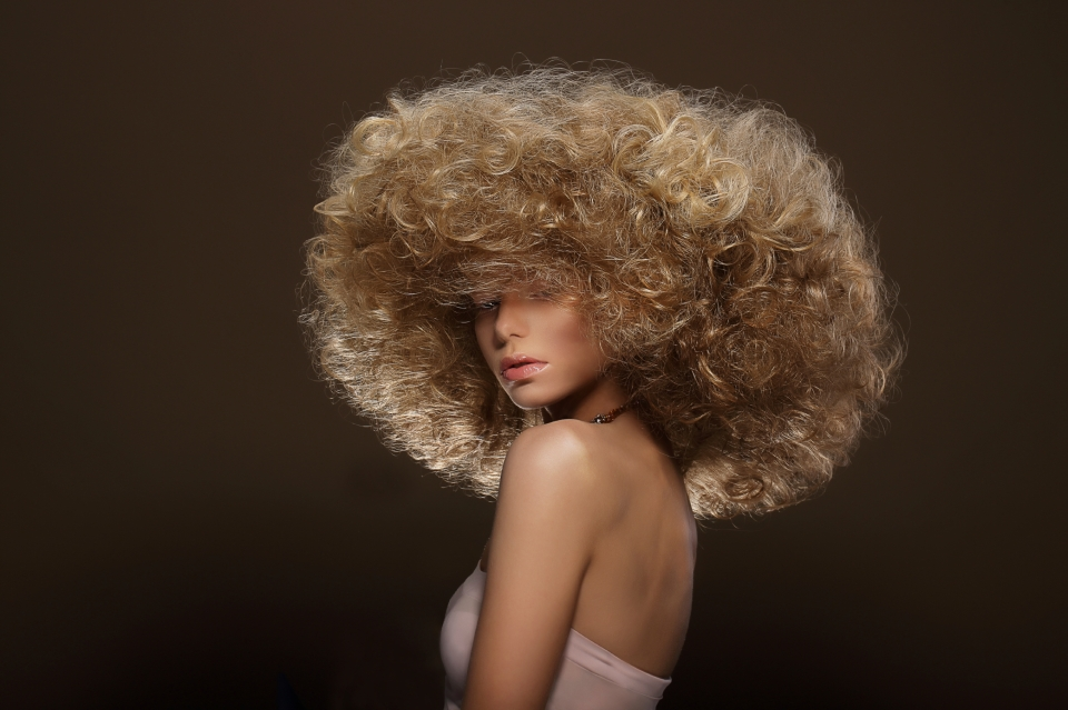 Updo. Vogue Style. Woman with Futuristic Hairdo